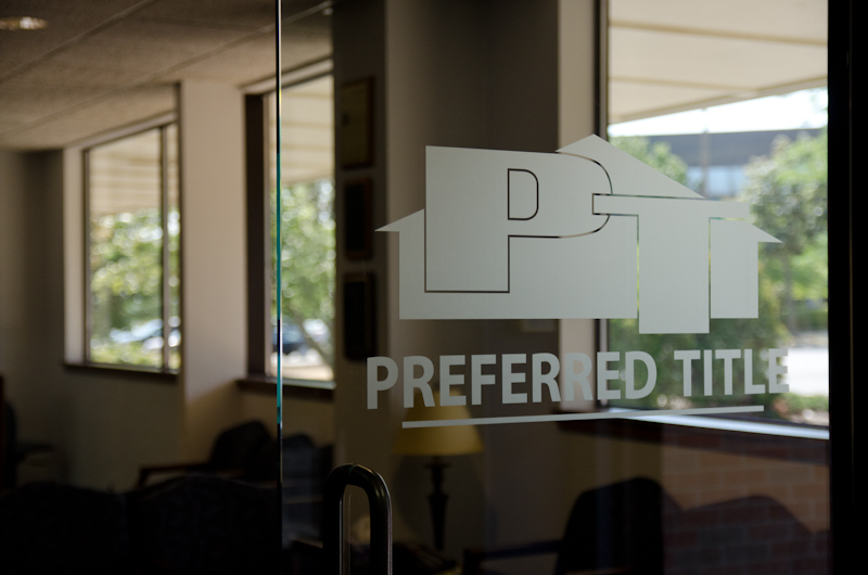 image of Preferred Title logo on a glass door to a conference room